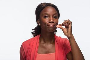 African American woman zips her mouth, horizontal photo