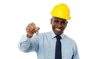 African American businessman holding a key photo
