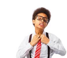 African American teenager unties his tie photo