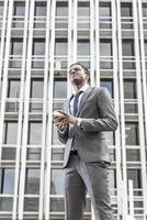 Handsome african american businessman with smart phone photo