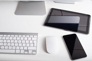 Wireless keyboard, mouse, tablet and smartphone photo