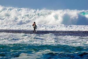 Fisherman walking on the reef photo