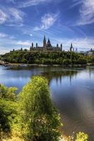 Vertical view of Canada's Parliament by the Ottawa River