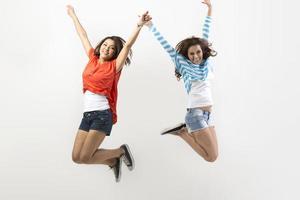 Two Asian women jumping