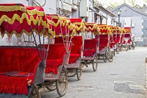Typical Asian rickshaws photo