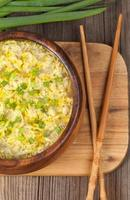 Hot vegetarian egg drop soup with starch noodlein wooden bowl photo