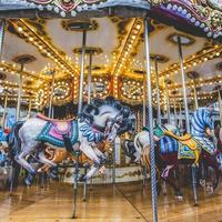 Old French carousel in a holiday park. photo