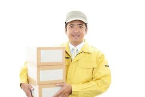 Asian courier delivering packages