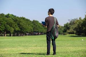 Asian student in park