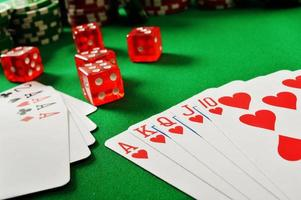 Composition with playing cards on green table