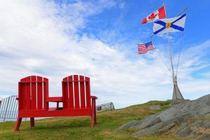 2 red chairs and 3 flags photo