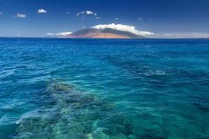 Reef in clear water with West Maui Mountains, Hawaii, USA