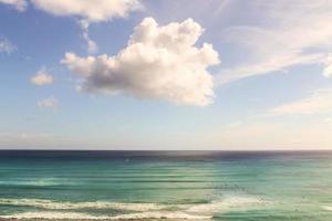 Surfers in the Pacific Ocean in Waikiki Beach