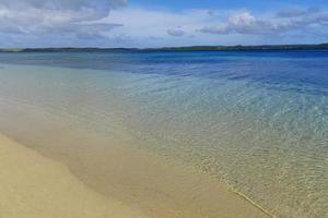Sandy beach and clear water, Ofu island, Tonga photo