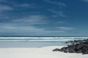 White sanded beach in Galapagos, Ecuador photo