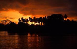 Beautiful silhouettte sunset in Solomon Islands photo