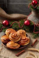 Cinnamon bun rolls christmas sweet dessert on vintage cloth with