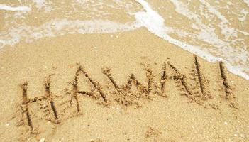 vakantie in Hawaï geschreven op zand