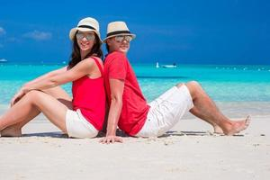 Close up of couple on tropical white beach photo