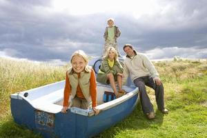 Young family sitting in boat photo
