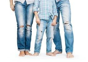 Family legs in tattered jeans photo