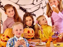 Family on Halloween party with children