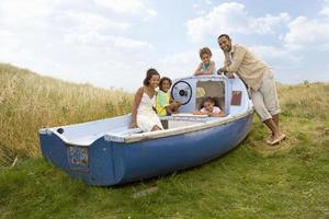 Portrait of family sitting on boat