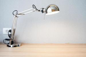 sliver desk lamp on desk photo