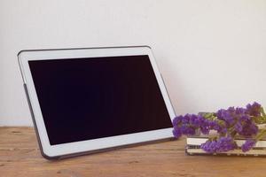 Tablet PC on wooden desk.