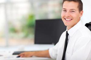 businessman sitting at office desk photo