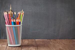 School and office supplies on classroom table