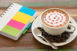 coffee latte art on the wood desk