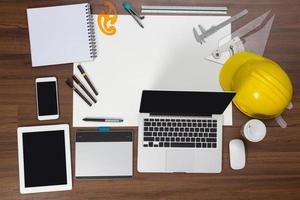 Office desk background with construction project ideas concept