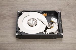 Open harddisk on wood desk