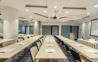 Rows of desks in lecture room