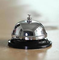 service bell on the hotel reception desk photo
