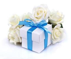 white flowers and gift box photo