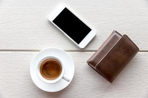 coffee cup on table and mobile phone,wallet
