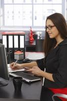 Side view of businesswoman at desk