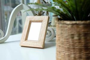 Photo frame on wooden table.