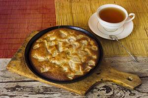 Charlotte. Apple pie with tea