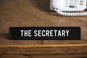 la secretaria, firma de trabajo, negocios y oficina. foto