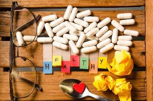 Healthy alphabet and capsule drug with glasses