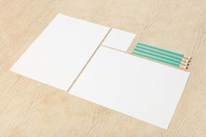 Blanks of empty paper with pencils. photo
