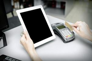 Bank terminal and tablet pc photo