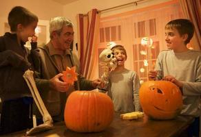 Happy nephews and Grandpa have fun for Halloween night preparatives