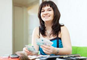 happy  girl calculates the family budget photo