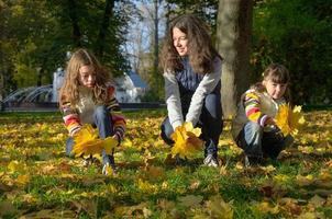 Happy family in autumn park photo