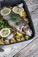 Baked trout with potatoes.