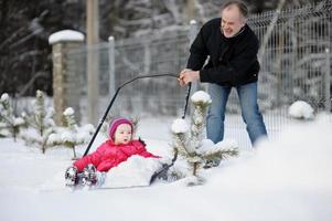 Winter fun: having a ride on snow shovel photo